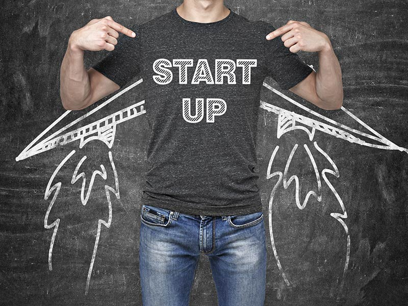 Man with start up tee shirt and wings